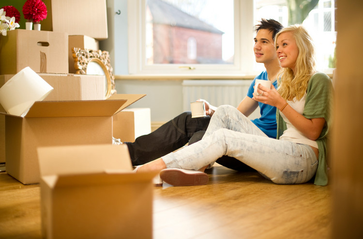 couple-taking-a-coffee-break-from-packing-boxes