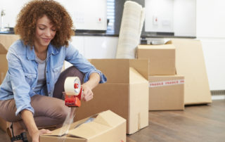 woman packing to move to Sydney