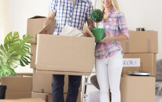 couple moving boxes with Sydney removalists