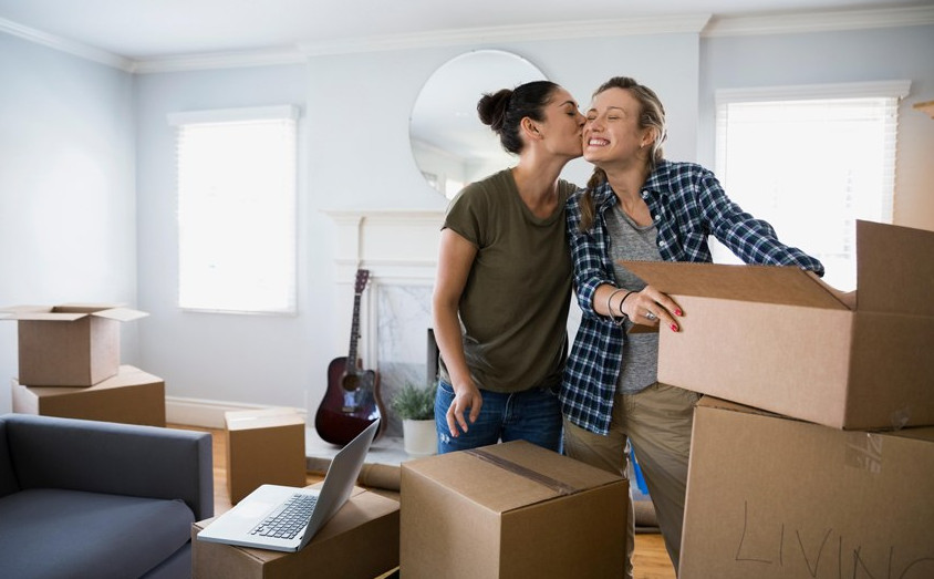 couple booking interstate removalists for their long distance move