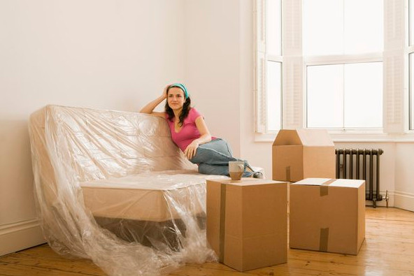 woman packed and ready to relocate to Baulkham Hills