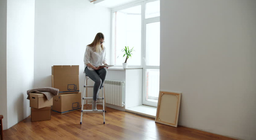woman waiting for removalists to move boxes in Balgowlah